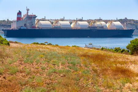 Huge tanker gas carrier at the berth of a power station on the island Malta. Marsaxlokk.