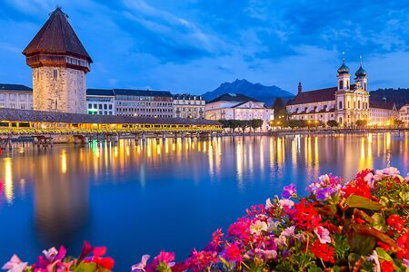 Scenic view of the Chapel, Kapellbrucke bridge, Wasserturm tower in the lantern light at sunrise. Lucerne. Switzerland.