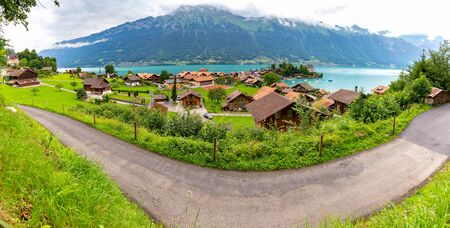 Panorama of the Swiss village of Iseltwald on the famous lake Brienz. Фото со стока