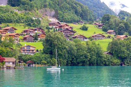 The traditional Swiss village of Iseltwald on the famous lake Brienz. Switzerland.