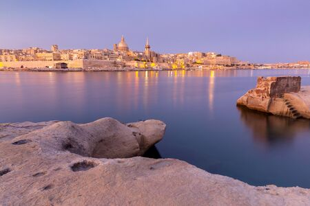 Malta. The coastline along Valletta and the harbor at sunrise.