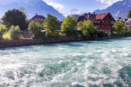 Interlaken. Mountain river Aare passing through the city.