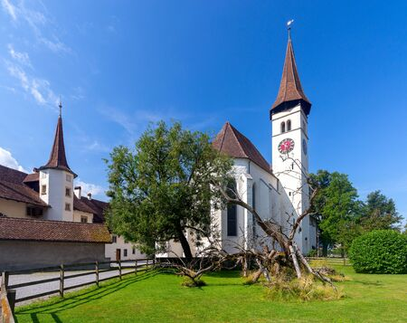 Interlaken. White catholic church with a bell tower on a sunny morning. Stock Photo