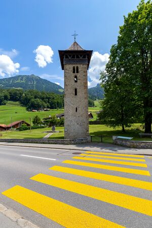 Lungern. Old stone bell tower in a swiss village.