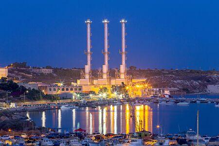Marsaxlokk. Delimara main power station at sunset. Stok Fotoğraf