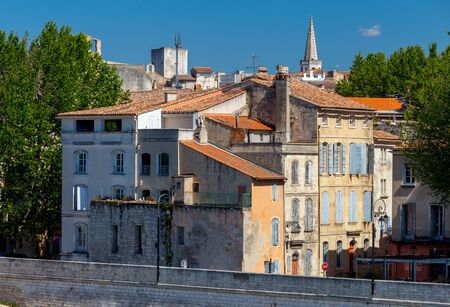 Arles. City embankment and facades of old houses.