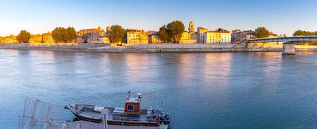 Arles. Panoramic view of the city promenade and the city at sunset.