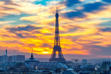 Scenic view of the city and the silhouette of the Eiffel tower on a sunset background. Paris. France.