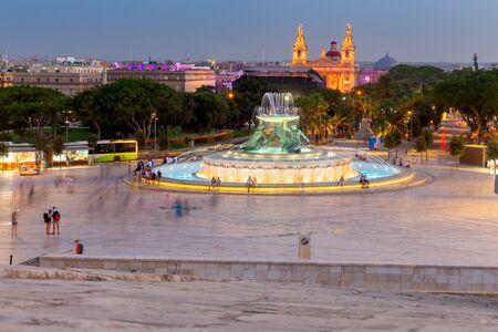Malta. Triton Fountain at sunset.