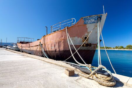Old rusty barge ship near the city promenade. Omis. Croatia. 스톡 콘텐츠 - 131955058