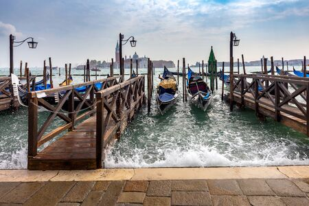 Large Venetian lagoon, gondolas and promenade.