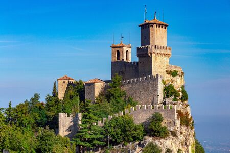 Scenic view of old medieval towers over the valley in the early morning. San Marino. Italy.