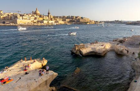Marsaxlokk, Valletta - July 7, 2019 : Scenic view of the old city and the bay at sunset. Valletta Malta. Editorial