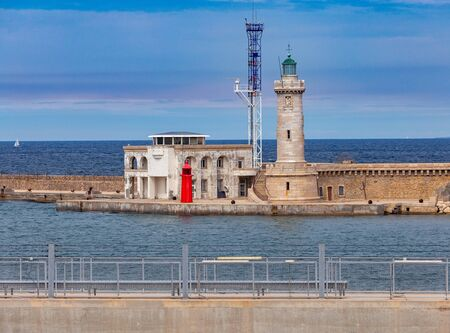 Old stone lighthouse in the old port. Marseilles. France.