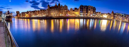 Gdansk. Panorama of the city promenade in night illumination.