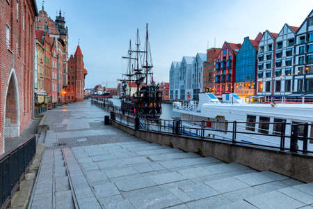City embankment and facades of medieval houses in the old city at dawn. Gdansk. Poland. Reklamní fotografie
