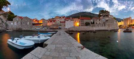 Dubrovnik. Old city walls and towers at sunset.