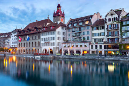 Lucerne. Old city embankment and medieval houses at dawn.