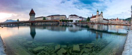 Lucerne. Panorama. The famous Chapel, Kapellbrucke bridge at dawn in night lighting. Stok Fotoğraf