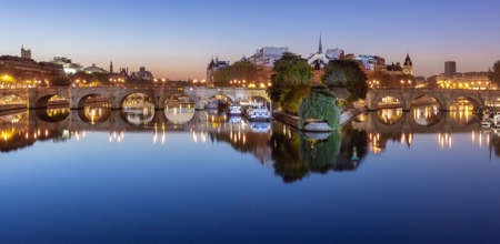 Paris. City embankment along the Seine river at dawn.