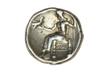 Greek silver Tetradrachm coin from Alexander the Great showing a seated Hercules, dated 336-323BC. Banco de Imagens