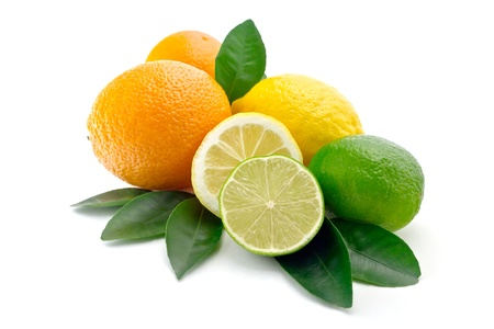 citrus on white background lime, orange, lemonhalves of lime and lemonfoliage of citrus trees photo