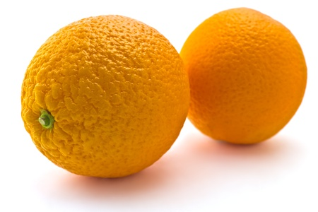 Juicy ripe oranges isolated on white background photo