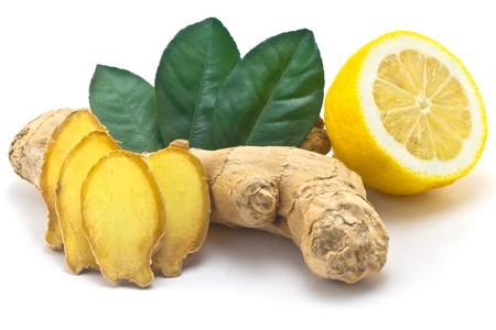ginger plant: Ginger, green leaves and half a lemon Stock Photo