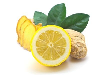 Ginger, green leaves and half a lemon Standard-Bild