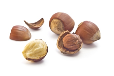 nuclei: hazelnuts in shell, shell fragments and purified nuclei Stock Photo