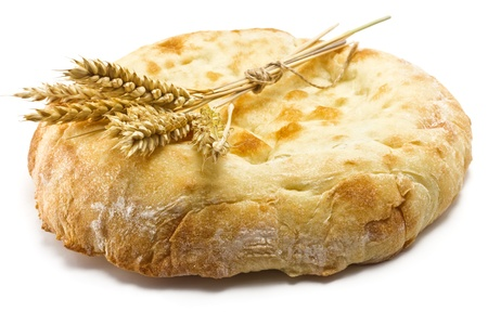 crispy pita bread and spikelets wheat on a white background photo