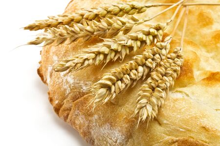 spikelets: crispy pita bread and spikelets wheat on a white background