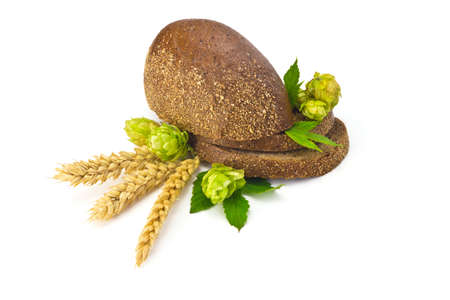 sliced bread, hops cones and spikelets on a white background photo