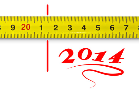 Yellow measuring tape and the new year 2014, as measured by the line photo