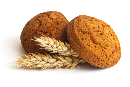 Oatmeal cookies and spikelets on white background