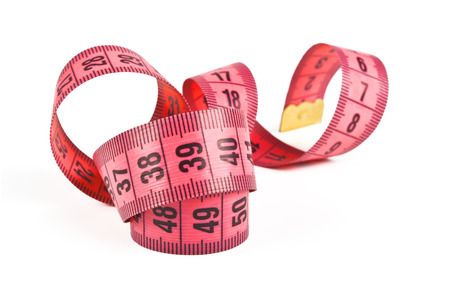 sartorial: pink tape measure twisted spiral on white background