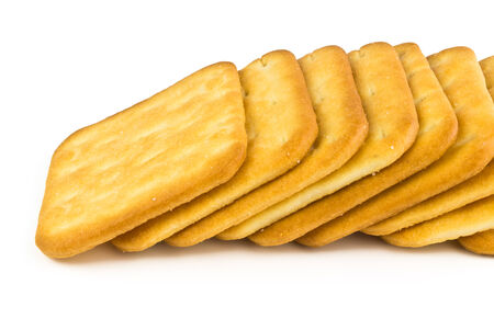 Many square plate of salty crackers isolated on white background photo