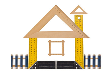 House of the tools,  Metallic tool to measure right angle, triangle and wooden ruler, pencil and tape measure on a white background Standard-Bild