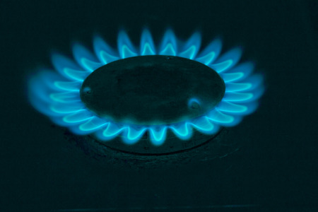 Fire natural gas burner in home on a dark background photo