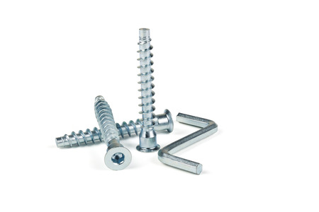 fixate: Screws and hexagon for a coupler furniture on a white background