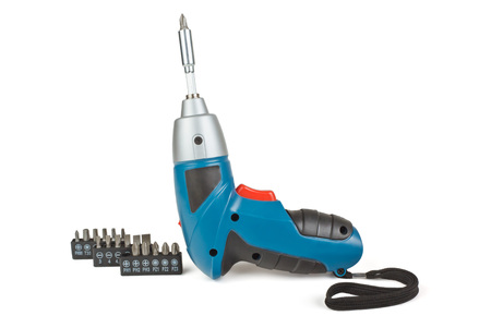 Wireless Electric screw gun and bits for different profiles on a white background