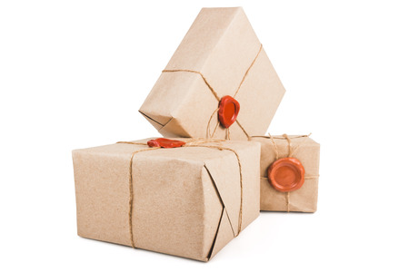 fastened: Parcels packed in thick paper, tied with a rope and fastened with wax seal isolated on white background