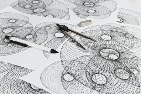 paper art projects: Circinus, pencil and eraser on a background sheet of paper with abstract geometric shapes