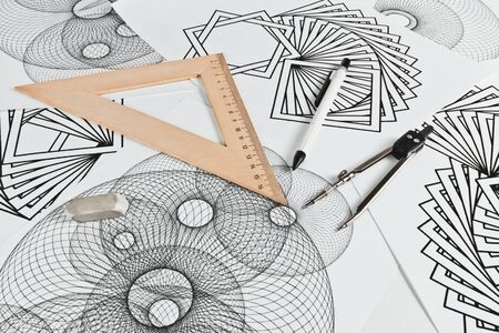 Circinus, ruler, pencil and eraser on a background sheet of paper with abstract geometric shapes Stock Photo