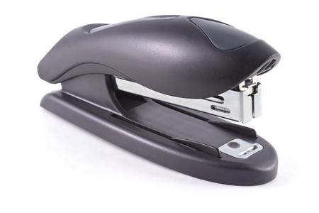 office stapler: Black stapler for rapid bonding of paper documents