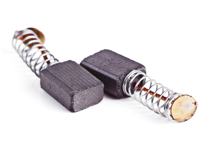 electric current: The electro-conductive graphite brushes electric current to the collector of the motor on a white background Stock Photo