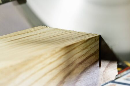 off cuts: Table saw cuts off a piece of wood