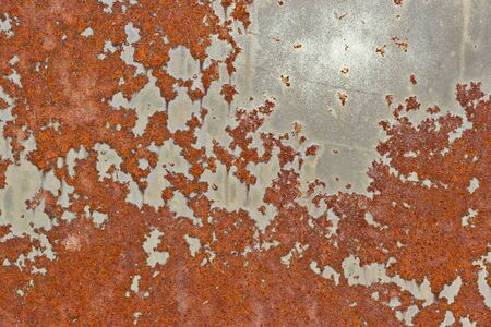 unevenly: Old painted surface with peeling paint and rust