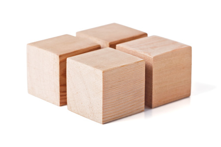 motility: Wooden toy cubes for childrens play isolated on white background