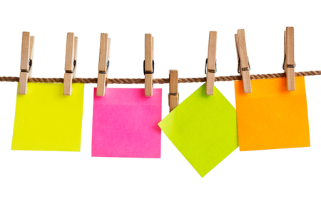 postit note: Color adhesive-message on a rope isolated on white background Stock Photo